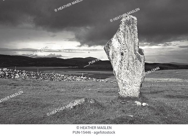 Single stone from the stone circle of Callanish on the Isle of Lewis, in between heavy rains showers