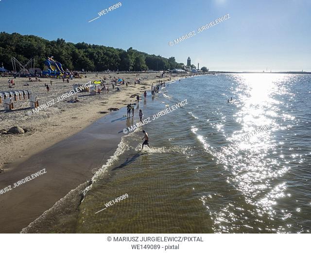 Coastline of the Baltic Sea in Kolobrzeg and historical lighthouse