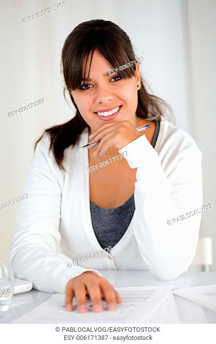 Portrait of a working young woman looking and smiling at you