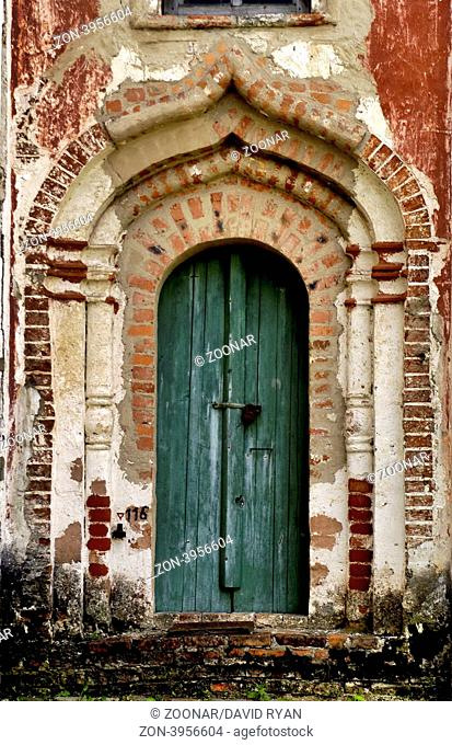 Russia, Goritzy, Monastery of the Resurrection, (founded by Saint Cyril in 1397), Door showing some restoration work (Vologda Oblast)