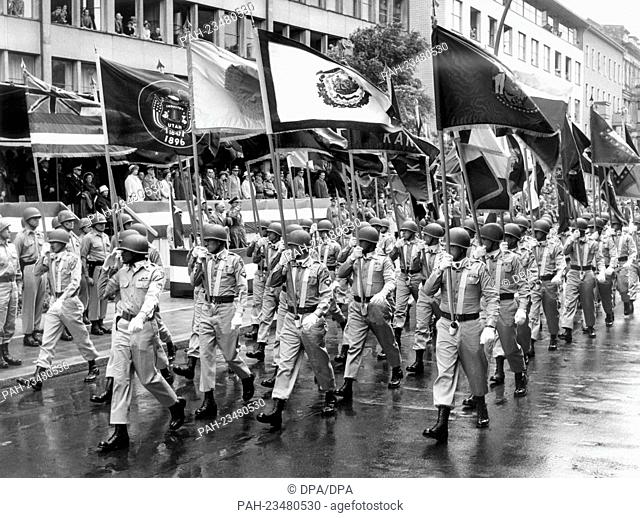 A flag bearer troop of the US Army marching past a VIP stand during a parade on occasion of the American Independence Day on 4th July 1962 in Berlin