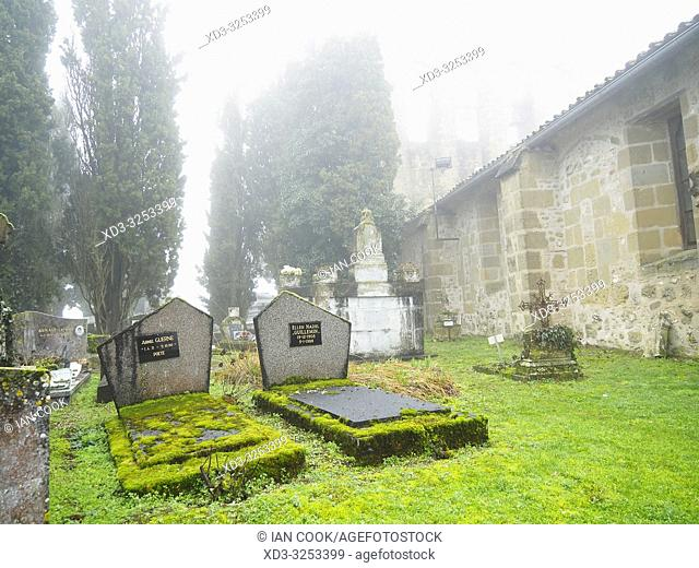 cemetery and Eglise de Tourtres in fog, Tourtres, Lot-et-Garonne Department, Nouvelle Aquitaine, France