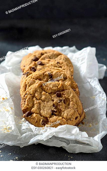 Baked chocolate chip cookies in the paper,selective focus