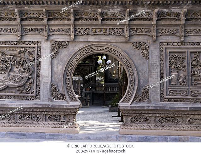 Yu Baba Gongbei chinese style gate in the mosque garden, Gansu province, Linxia, China