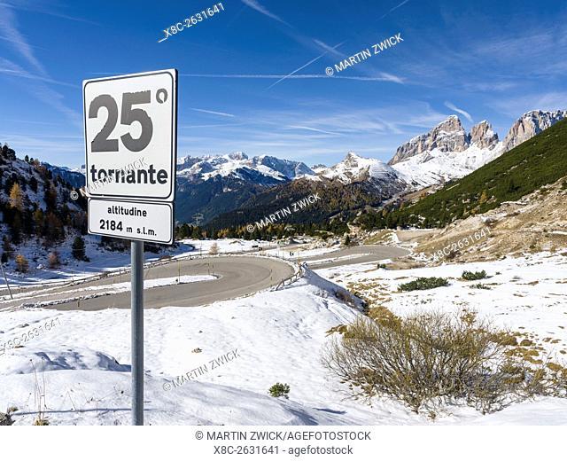 Pordoi Mountain Pass - Passo Pordoi in the Dolomites, approach from Val di Fassa. In the background Langkofel -Sassolungo mountain range