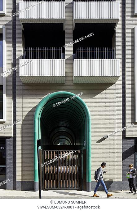 Exterior facade with view of tunnelled entrance. Rathbone Square, London, United Kingdom. Architect: Make Ltd, 2017