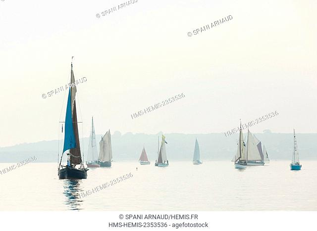 France, Finistere, Douarnenez, Sailboats tacking in the morning mist