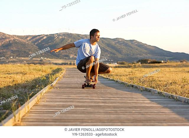 Young male riding a skateboard