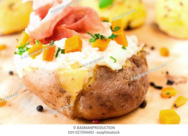 Stuffed potatoe with cheese cream and prosciutto