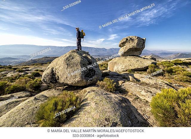 Trekker scanning the horizon in Sierra Paramera. Avila. Spain. Europe