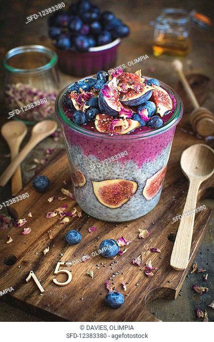 Chia pudding with figs, blueberries and dried rose petals