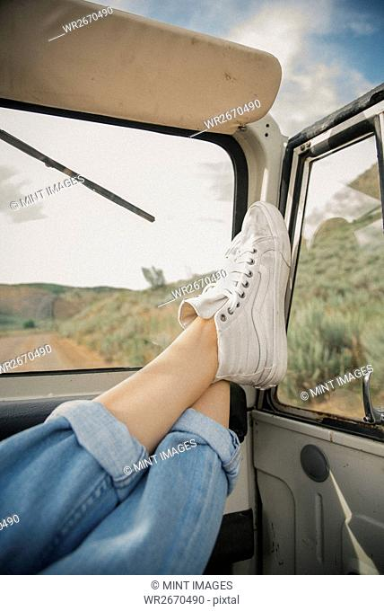 Feet on the dashboard of a jeep