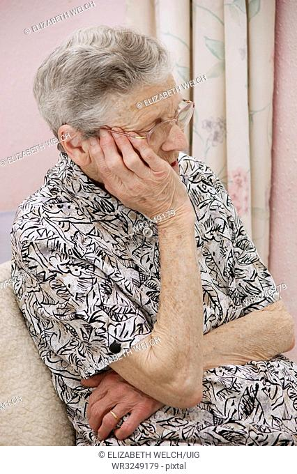 Vulnerable elderly woman feeling worried