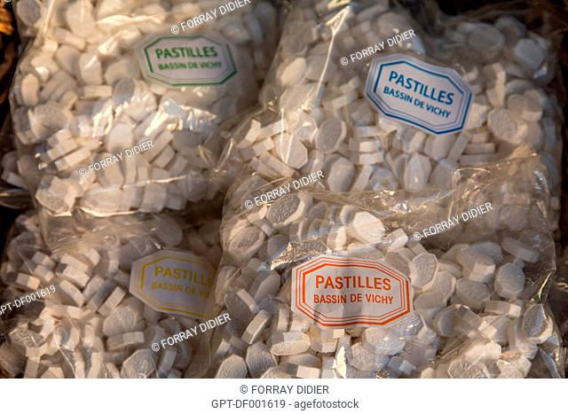 BAGS OF DIFFERENT CATEGORIES OF VICHY PASTILLES FROM THE BASSIN DE VICHY MAKE, LOZENGES MADE BY THE MOINET CONFECTIONERS, A FAMILY BUSINESS
