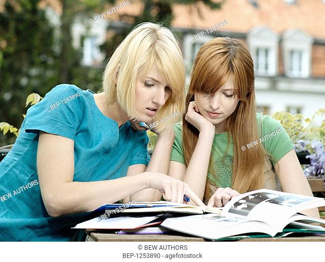 Two girls studing