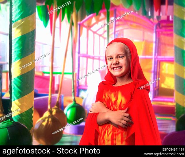 Happy little girl in a costume in the playing room