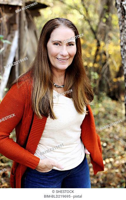 Caucasian woman standing in backyard
