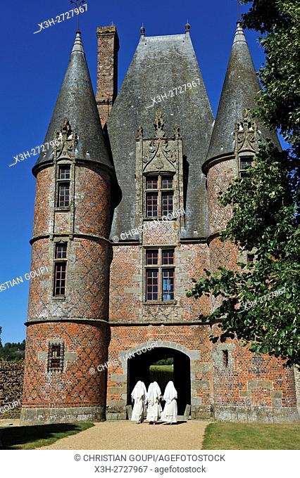 nuns at the entrance of the Chateau de Carrouges, Domfront, department of Orne, Normandie region, France, Europe