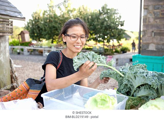 Woman shopping for greens at farmers market