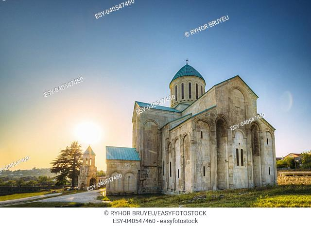 Kutaisi, Georgia. Sun In Sunset Time Above Old Walls Of Bagrati Cathedral. UNESCO World Heritage Site. Famous Landmark, Masterpiece Of The Medieval Georgian...