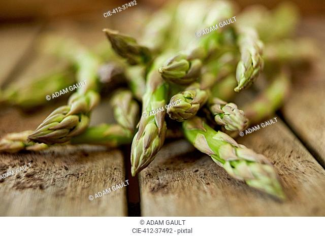 Still life close up fresh, organic, healthy, green asparagus tips on wood
