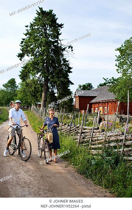 Mature couple cycling, Sweden