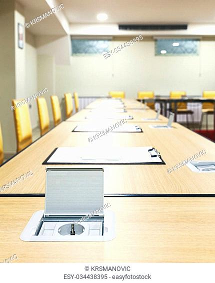 Interior of a modern conference room, tables with built in power supply
