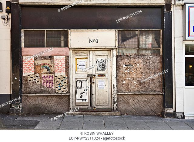 England, Merseyside, Liverpool. Boarded and locked shop front