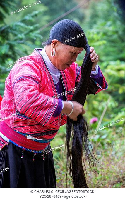 Longji, China. Woman of Yao Ethnic Minority Showing her Long Hair