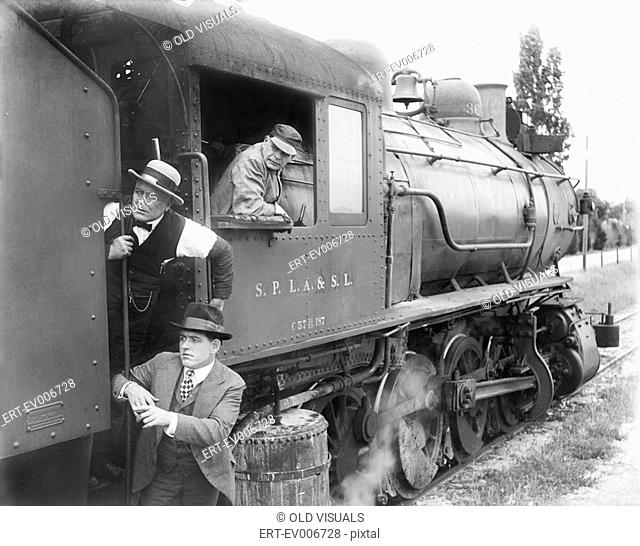 Three men waiting at a steam locomotive All persons depicted are not longer living and no estate exists Supplier warranties that there will be no model release...