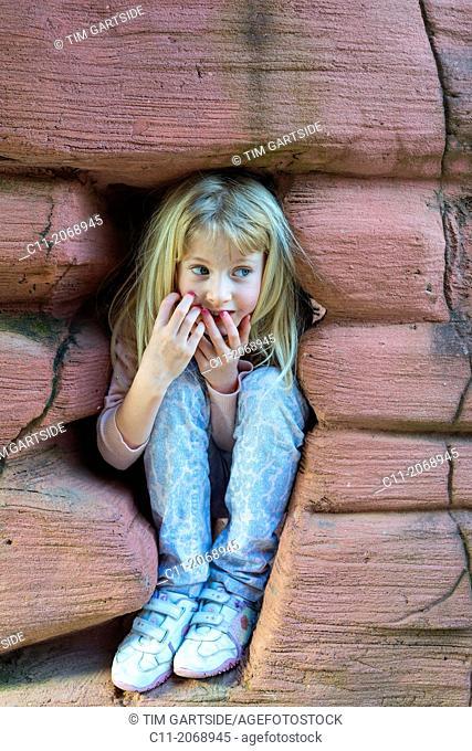 young girl happy playing hide and seek,cleveleys,lancashire,england,uk,europe