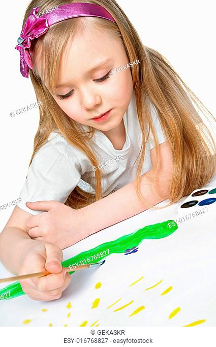 pretty little girl paints a watercolor painting