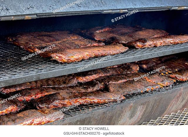 Racks of Spare Ribs Cooking on Grill
