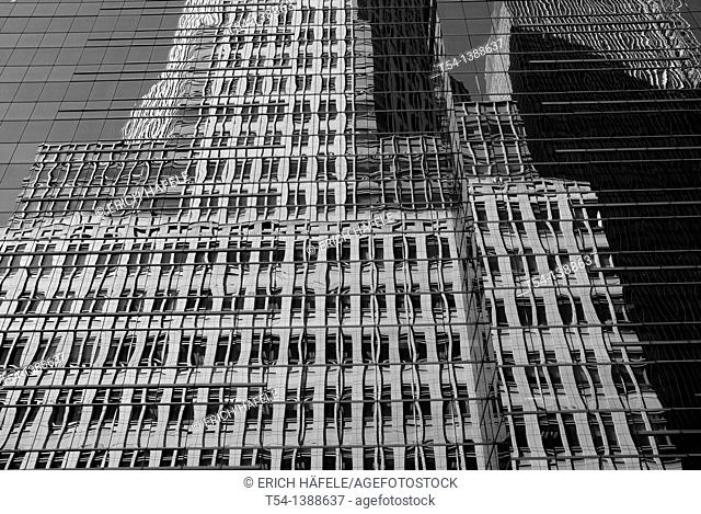 Glass facade of a tower in the financial district in Manhattan