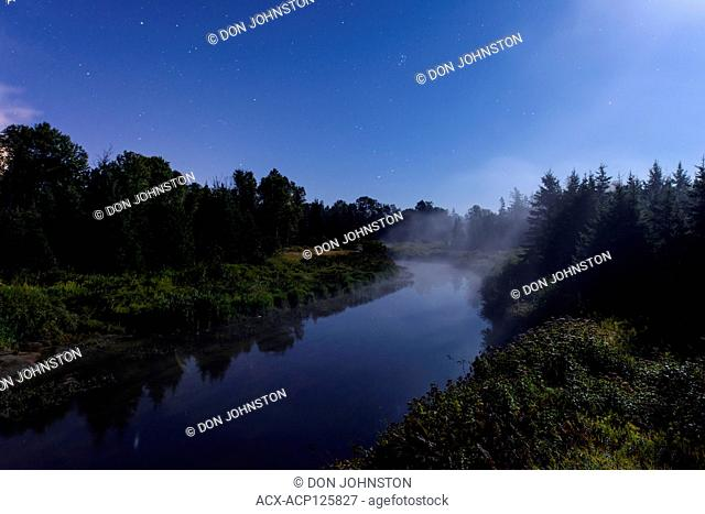 Risng mist on Junction Creek in moonlight, Greater Sudbury, Ontario, Canada