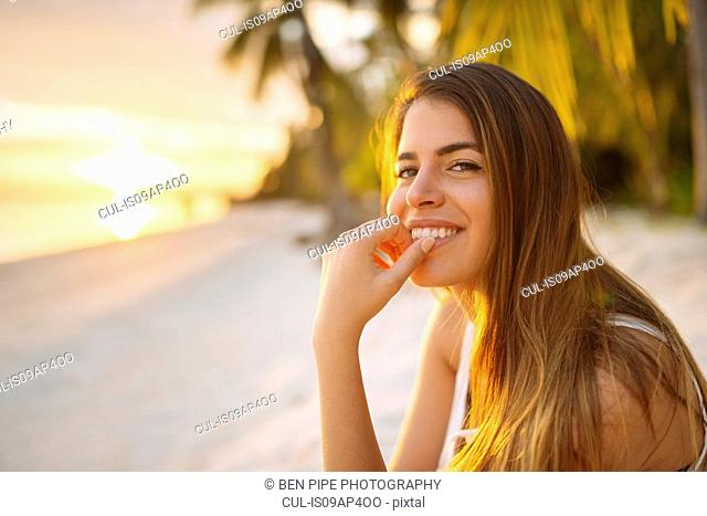 Portrait of young woman on Anda beach at sunset, Bohol Province, Philippines