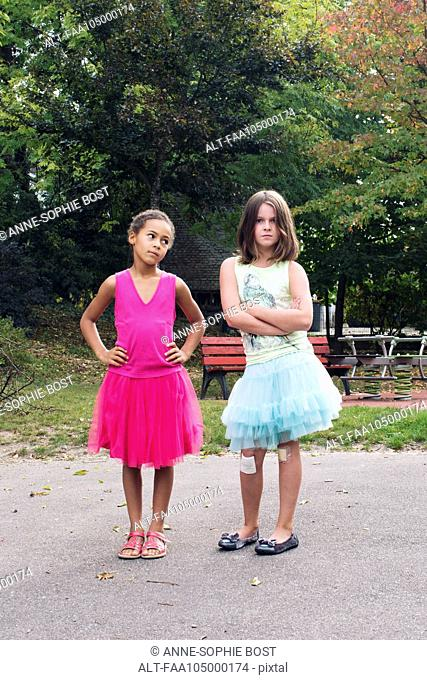 Girls dressed in tutus with tough expression on faces