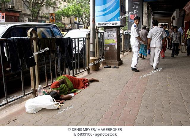 Although Kolkata would like to get rid of its image as the poorhouse of India, scenes such as this homeless woman sleeping on the pavement can be found even in...
