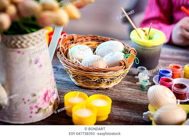 Easter decor,colouring eggs for eastertime at home.Happy easter! Happy family preparing for Easter.decorating Easter eggs