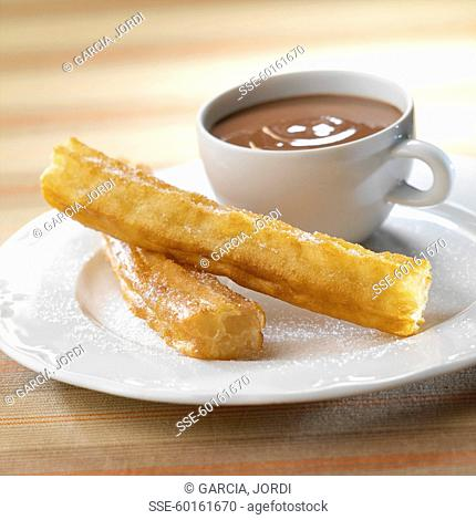 Churros and a cup of hot chocolate