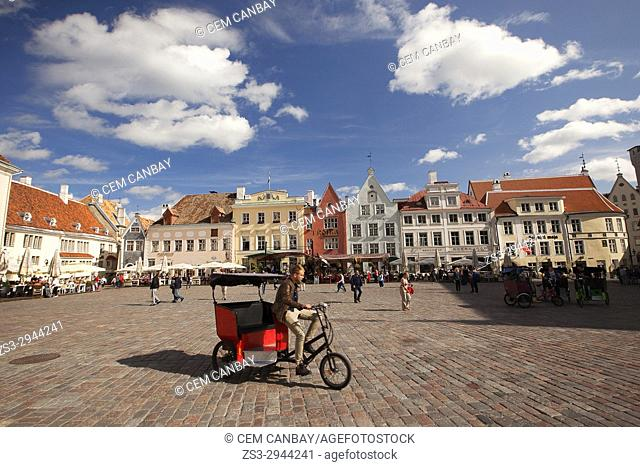 Bici taxi in front of the colorful houses in the main Square Raekoja Plats, Tallinn, Estonia, Baltic States, Europe