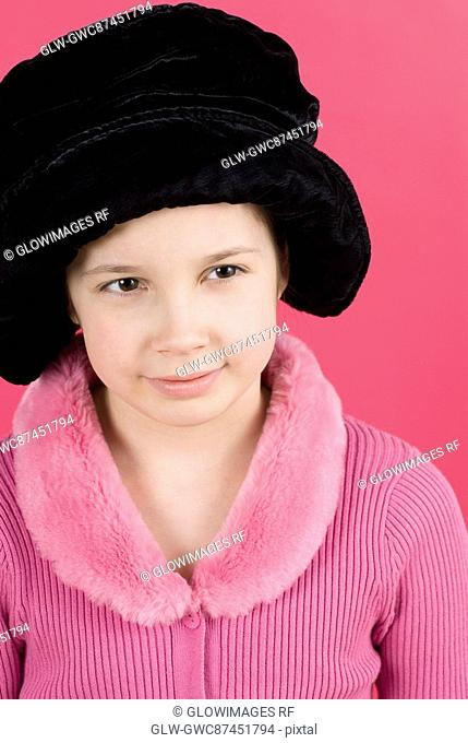 Close-up of a girl wearing a fur hat