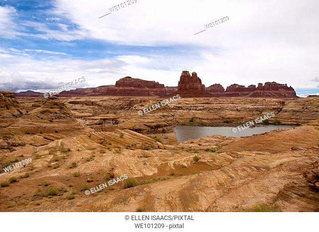 Dramatic swirling orange rock formations and red buttes at the head of Lake Powell in southern Utah, USA