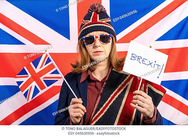 British redhead woman with UK flag and Brexit banner
