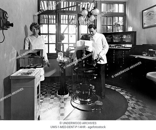 Battle Creek, Michigan: c. 1929 A dentist treating a woman patient at the Dental Department at John Harvey Kellogg's Battle Creek Sanitarium