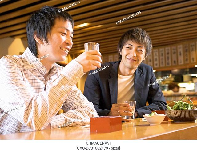 Man Having Drinks in Japanese Style Pub