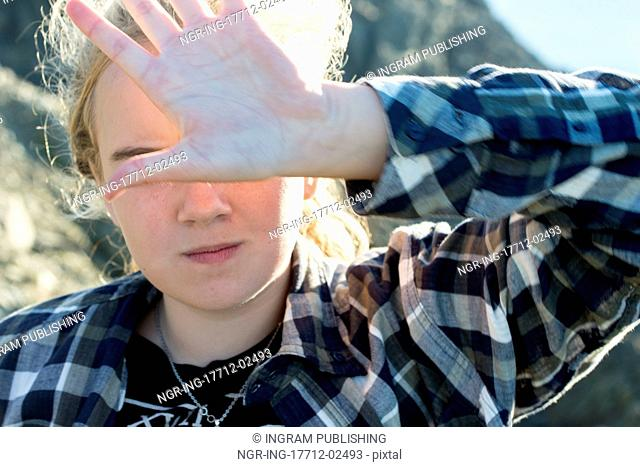 Girl covering face with hand, Long Point Hiking Trail, Crow Head, Twillingate, North Twillingate Island, Newfoundland And Labrador, Canada