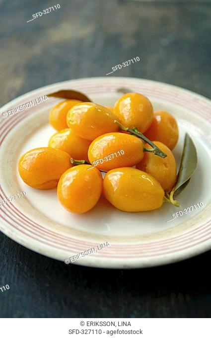 Bottled kumquats on a plate