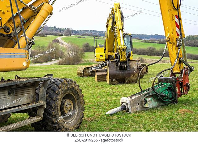 Construction machinery like excavators and jackhammers on a property for landscaping