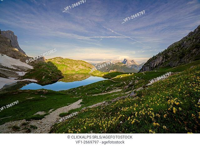 Europe, Italy, Veneto, Belluno. The basin with mountain lake Coldai towards the Marmolada, Dolomites, Civetta group
